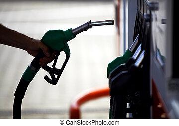 Fuel pump - Detail of a hand holding a fuel pump at a...