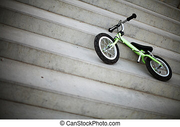 Small bike - Small bicycle without pedals, on some stairs