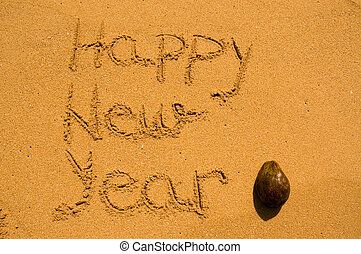 Happy New Year in the sand with coconut