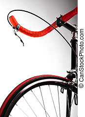 Red bicycle - Detail on a handlebar and wheel of a bicycle