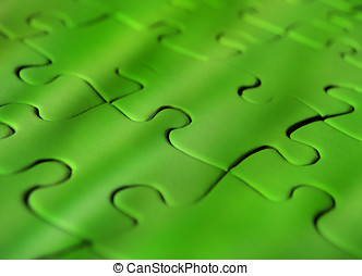 Green jigsaw puzzle - Green coloured jigsaw puzzle with...