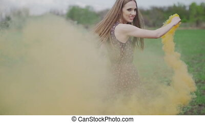 Happy young woman in dark dress with floral print having fun...