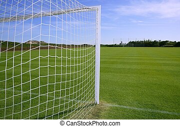 Net soccer goal football green grass field sunny day...
