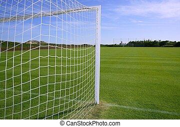 Net soccer goal football green grass field sunny day...