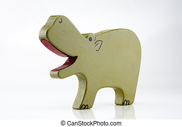 Wooden Hippo Three Quarter on White - A painted wooden hippo...