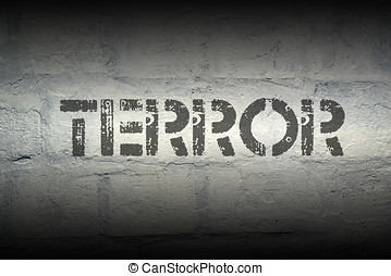 terror stencil print on the grunge white brick wall