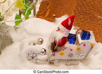 Doll fabric of santa in snow - doll of Santa Claus sitting...