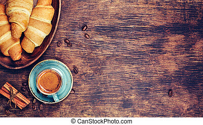 Cup of coffee and croissant