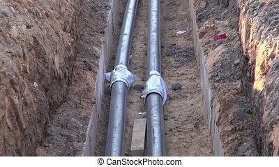 Central heating pipes in the ditch
