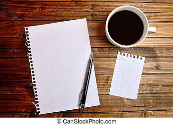 Empty paper with cup of coffee