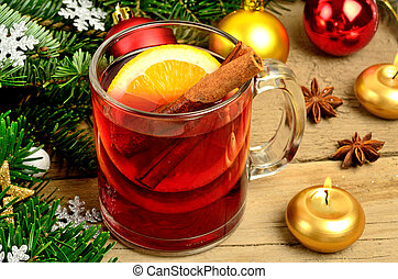 Glass of red wine with christmas decoration on wooden table