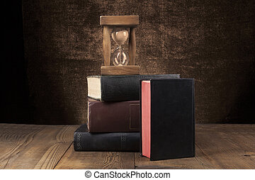 Old Books Pile - Old Books on Wood Table With Hourglass