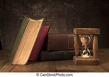 Old Books With Hourglass