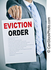 man with an eviction order - a young caucasian man wearing a...