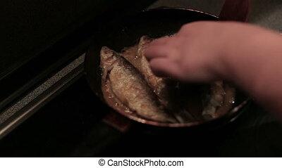 Stirring seafood in pan, close up.
