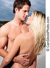Seductive couple - Goodlooking young couple topless on the...