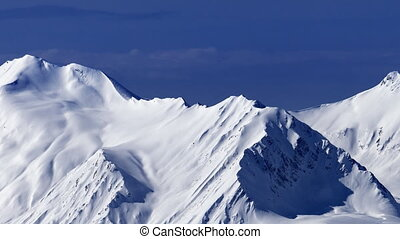 View on off-piste snowy slope at nice day Caucasus...