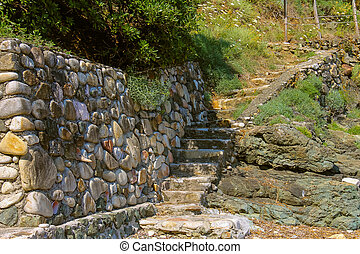 Stone stairs on the coast of the Tyrrhenian Sea, Marciana...