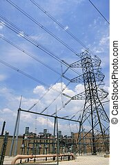Electric tower and cables over blue sky
