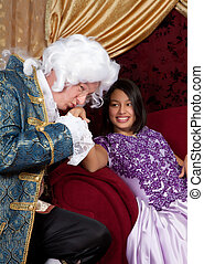 Kissing hand - Man in victorian livery costume kissing a...