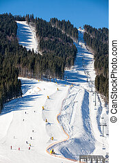 Skiers at ski slope