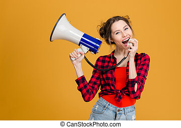 Casual woman screaming in megaphone - Portrait of a young...
