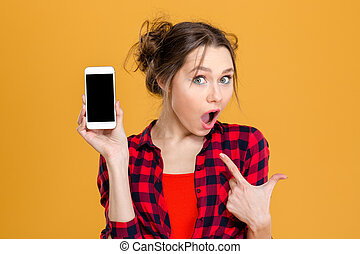 Amazed woman showing blank smartphone screen - Portrait of a...