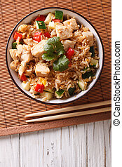 Tyahan - fried rice with chicken and vegetables. vertical...