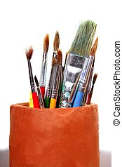 Artist brushes clay pot isolated on white