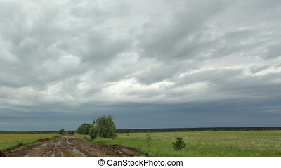 Movement of clouds over a dirt road Lubinsky District, Omsk...