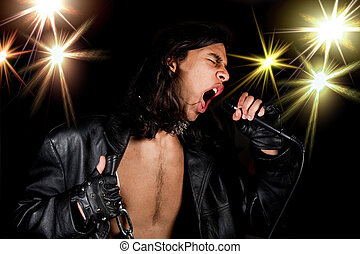 Singing loud - Young handsome rock singer against a dark...