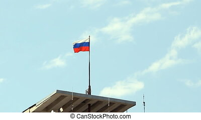 Tricolor of Russian Federation flag fluttering in the wind