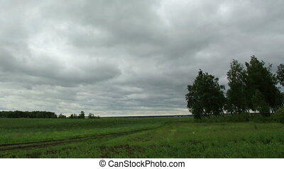 Movement of clouds over a dirt road Ishimsky district,...
