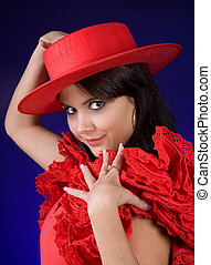 Red hat - Young Spanish Flamenco dancer showing her red hat