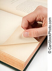Next page - Female hand turning a page of an old book