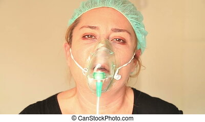 Patient with oxygen mask - Portrait of a sick, sad woman...