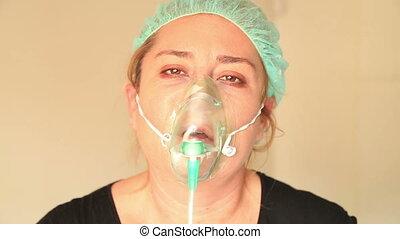 Patient with oxygen mask - Portrait of a sick, sad woman...