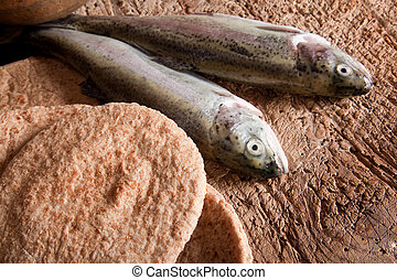 Fish and bread - Still life of five loaves of bread and two...