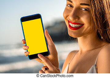 Woman showing phone with white screen - Young and pretty...