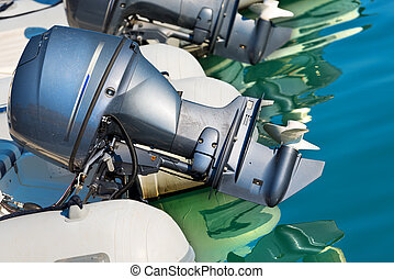 Two Outboard Boat Motors - Detail of two outboard used...