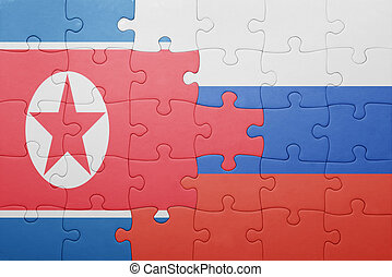 puzzle with the national flag of north korea and russia...