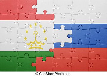 puzzle with the national flag of tajikistan and russia ....