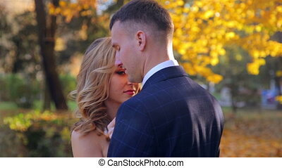 Beautiful young couple in the autumn park
