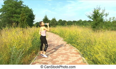 Girl drinks water after playing sports - Subject healthy...