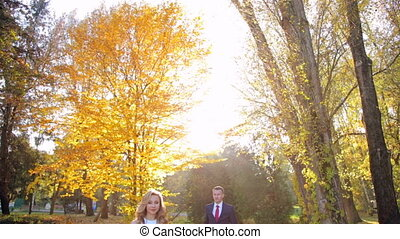 couple kissing outdoor in the  autumn park
