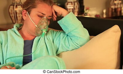 Portrait of woman with oxygen mask - Portrait of a diseased...