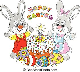 214eps - Happy little rabbits with a decorated Easter cake...