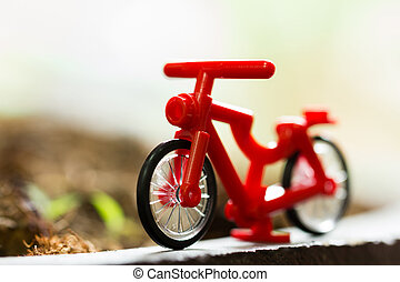 Closeup red bicycle model with soft focus.