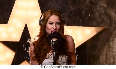 girl singer recording a song in music studio,slow motion,...