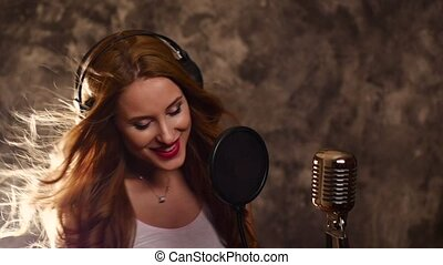 girl listening to music and singing with Retro Microphone,...